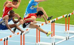 Shunya Takayama(R) of Japan during 110m men hurdles - stock photo