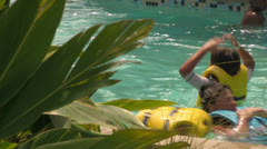 Close-up of People Swimming-by in Water Park Lazy River Stock Footage
