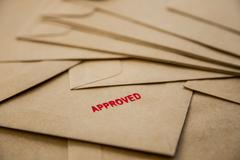 approved sign on envelope - stock photo