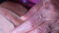 A pair of old hands clasped together Stock Footage