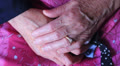 A pair of old hands clasped together HD Footage