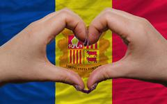 over national flag of andorra showed heart and love gesture made by hands - stock photo
