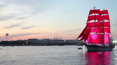 Scarlet sails ship passing Neva river, St. Petersburg, Russia Stock Footage