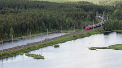 Passenger train passing in forest, Karelia, Russia. Aerial view - stock footage