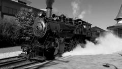Steam Locomotive Departs Station - stock footage
