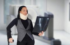 woman with cervical collar and radiography - stock photo