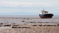 Old Fisherman's Boat on Beach at Low Tide HD Stock Footage