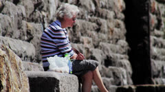 Old Woman Eating Her Lunch at the Seaside HD Stock Footage