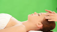 Stock Video Footage of Beautiful young relaxed woman enjoy receiving face massage