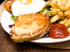 french toasted sandwich - croque madame - stock photo