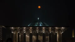 Moon Rises Over Mosque Timelapse Stock Footage