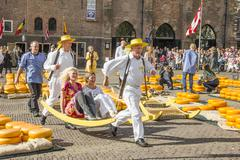 Carriers walking with many cheeses in Alkmaar Stock Photos