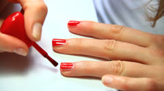 Polishing red nails Stock Footage