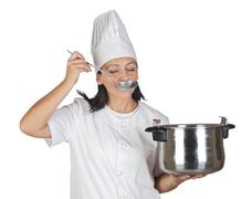 pretty cook girl testing a meal - stock photo