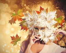 Fashion woman with autumnal carnival mask Stock Illustration