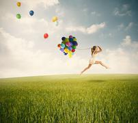 jumping with balloons in a green field - stock illustration
