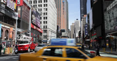 Ultra HD 4K Utility Red Truck Traffic Broadway Times Square, Yellow Cabs Passing Stock Footage