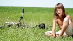 Boy resting in a field, boy daydreaming in a field alone Stock Footage