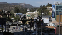 Highland Avenue, Franklin Hollywood Hills Sign LA Crowded Transportation Traffic Stock Footage