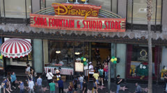 Disney Store, Hollywood Boulevard, Stars, Walk of Fame, Crowds People Walking - stock footage