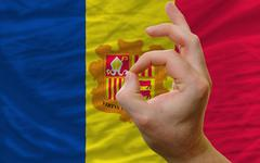 Stock Photo of ok gesture in front of andorra national flag