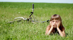 boy resting in a field, boy daydreaming in a field alone - stock footage