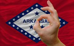 ok gesture in front of arkansas us state flag - stock photo