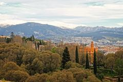 granada buildings and mountains - stock photo
