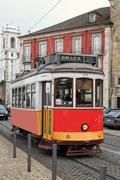 Stock Photo of historic streetcar in alfama lisbon