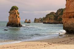 dona ana beach, lagos, portugal at sunset - stock photo