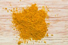 curry powder pinch - stock photo