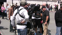 Film crew with cameraman preparing to film TV Broadcast on a film set Stock Footage