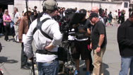 Stock Video Footage of Film crew with cameraman preparing to film TV Broadcast on a film set