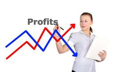 Businesswoman drawing graph Stock Photos
