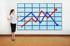 Woman pointing at scheme Stock Photos