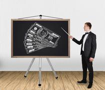 Blackboard with dollars Stock Photos
