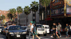 El Capitan Disney Theatre, LA, Hollywood Boulevard, Crowds People Passing, Cars Stock Footage