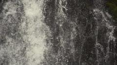 Waterfall descends rock wall Stock Footage
