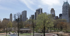 Ultra HD 4K New York City Skyline, People Relax in NYC Central Park, Spring - stock footage