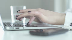 Laptop keyboard close up. women's hands tipping. working on laptop in office Stock Footage