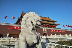 The stone lion statue and tiananmen tower - stock photo
