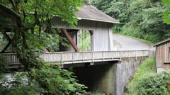 Cedar Creek Grist Mill with Covered Bridge in Woodland Washington Stock Footage