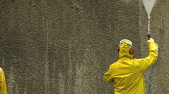 Worker cleaning wall high pressure water cannon Stock Footage