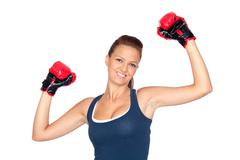 attractive girl practicing boxing - stock photo