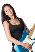 Attractive girl with a blue electric guitar Stock Photos
