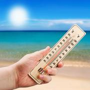 Thermometer in hand shows the intense heat Stock Photos