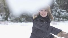 Women throwing snow ball slow motion Stock Footage