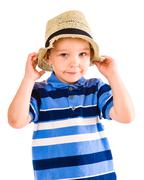 Boy and hat Stock Photos