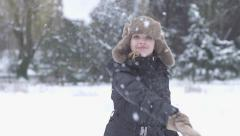 Throwing snow ball women winter time slow motion Stock Footage