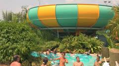 Big Bowl Water Slide with People in Waterpark Pool Stock Footage